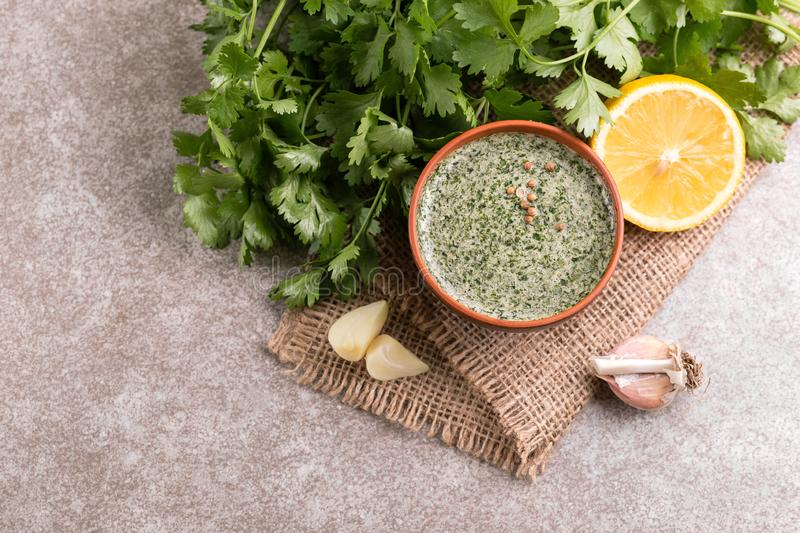 Sweet and sour green homemade sauce with cilantro, lemon and gar stock photo