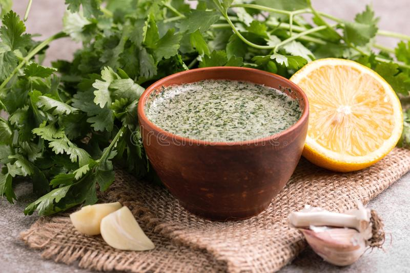 Sweet and sour green homemade sauce with cilantro, lemon and gar stock photos
