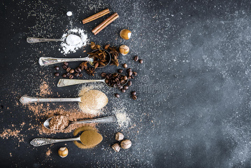 Sweet spices in the spoons on the table royalty free stock image