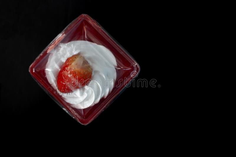 Sweet strawberry cake in plastic box. royalty free stock photography