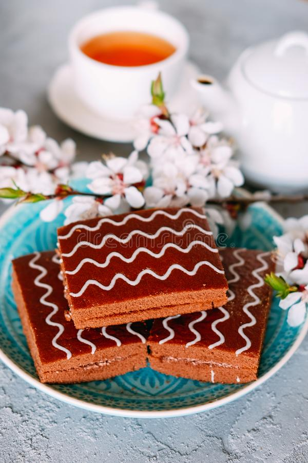 Sweet sunday dessert. Chocolate brownies with black tea stock image