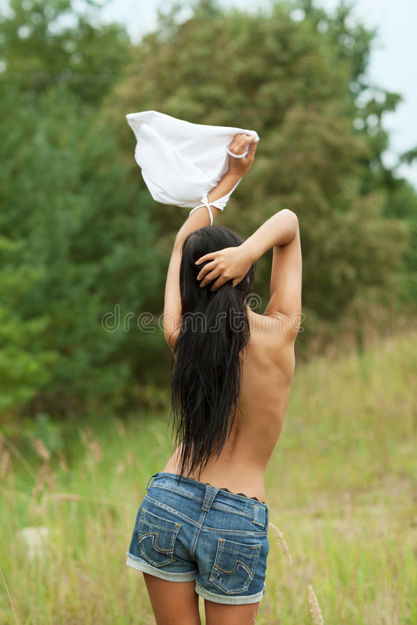 Sweet surrender. Surrendering girl with white flag royalty free stock photo