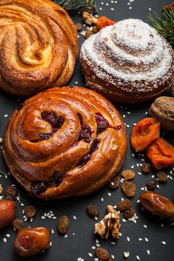 Sweet Swedish pastries with dry cherries. Dates, nuts, raisins and dried apricots.  stock image