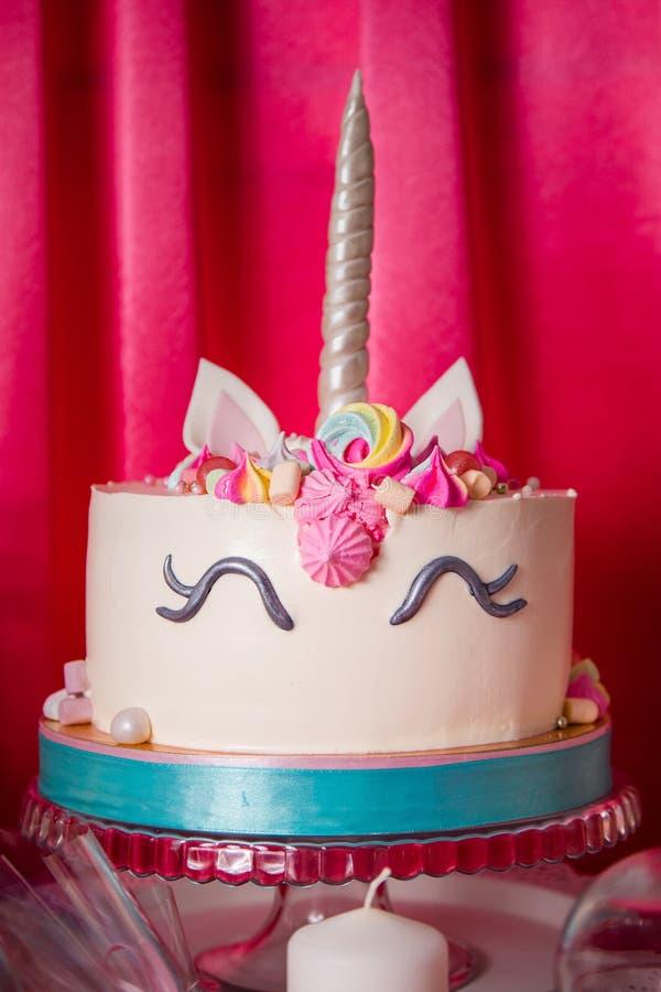 Sweet table and big unicorn cake for baby girl first birthday. Sweet table and big unicorn cake for baby girl first birthday royalty free stock photography