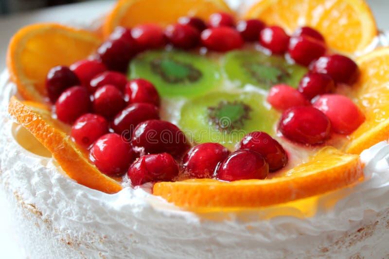 Sweet tasty cake with cream, fresh fruit and jelly stock photos