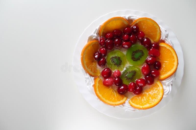 Sweet tasty cake with cream, fresh fruit and jelly stock photo