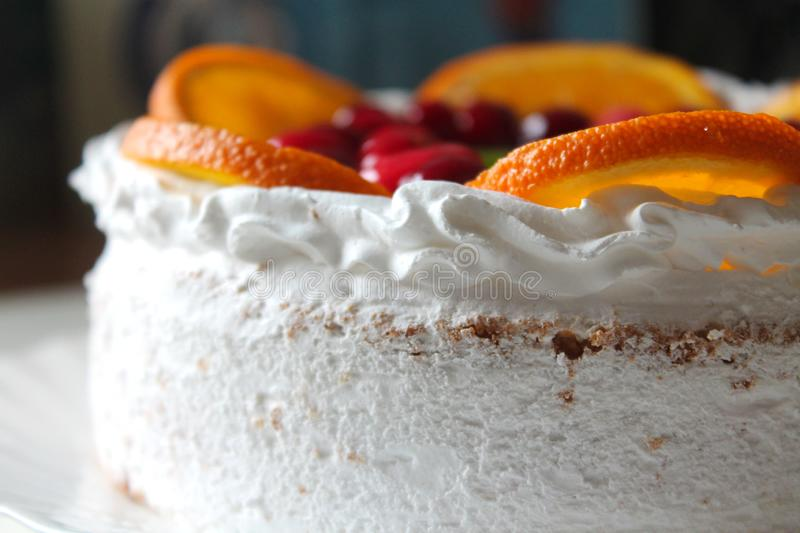 Sweet tasty cake with cream, fresh fruit and jelly royalty free stock photography