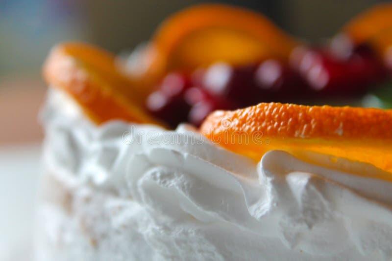 Sweet tasty cake with cream, fresh fruit and jelly stock image