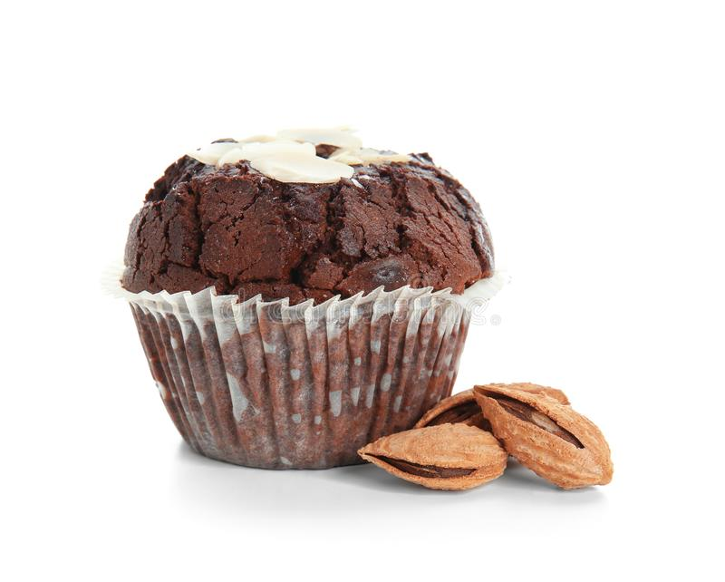 Sweet tasty chocolate muffin with almonds on white background royalty free stock image