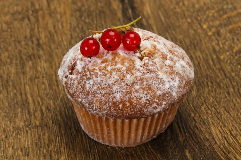 Sweet tasty muffin with red currants royalty free stock photos
