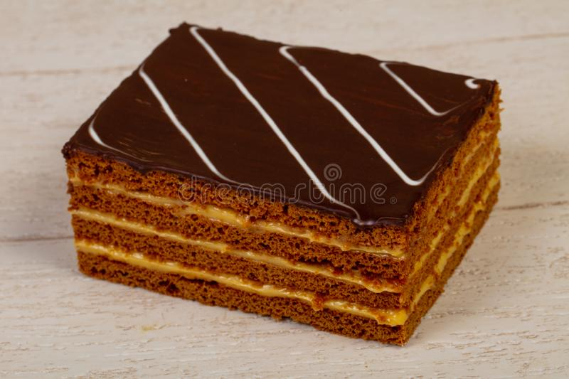 Sweet tasty pastry. Over the wooden background royalty free stock image