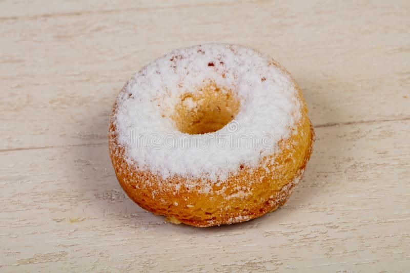 Sweet tasty pastry. Over the wooden background stock photos