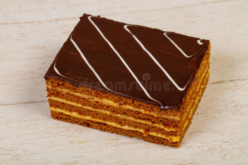 Sweet tasty pastry. Over the wooden background royalty free stock photography