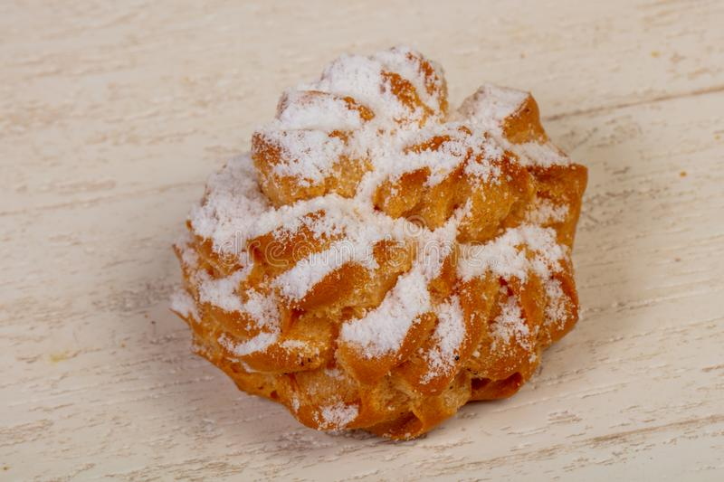 Sweet tasty pastry. Over the wooden background stock images