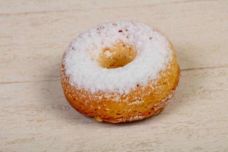 Sweet tasty pastry. Over the wooden background stock photography