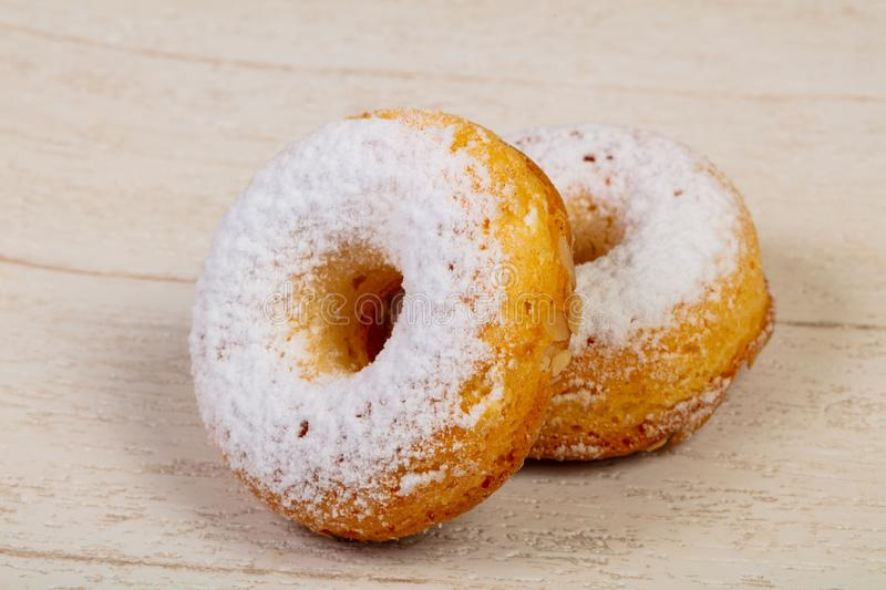 Sweet tasty pastry. Over the wooden background royalty free stock photos