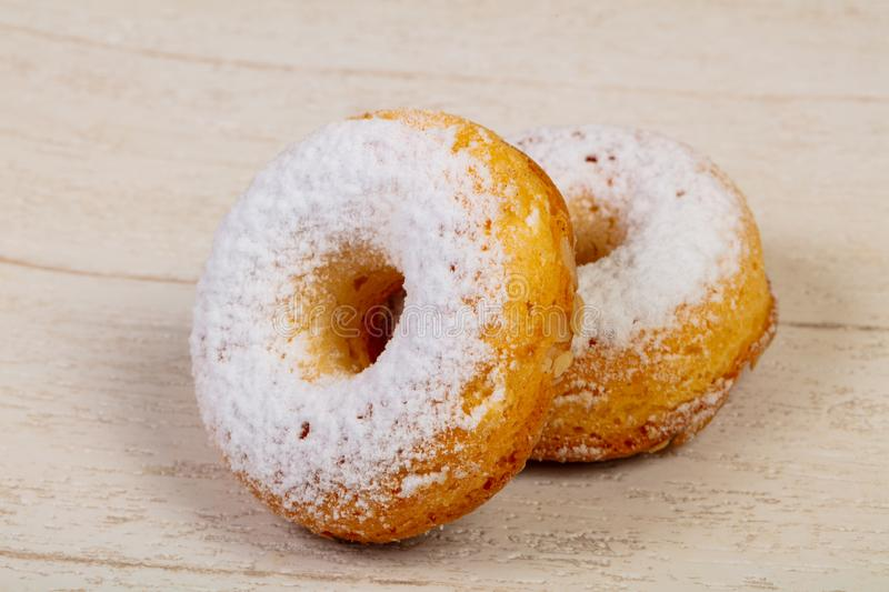 Sweet tasty pastry. Over the wooden background royalty free stock photo