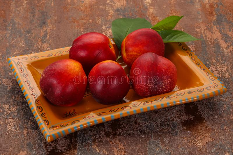 Sweet tasty ripe few nectarines royalty free stock photos