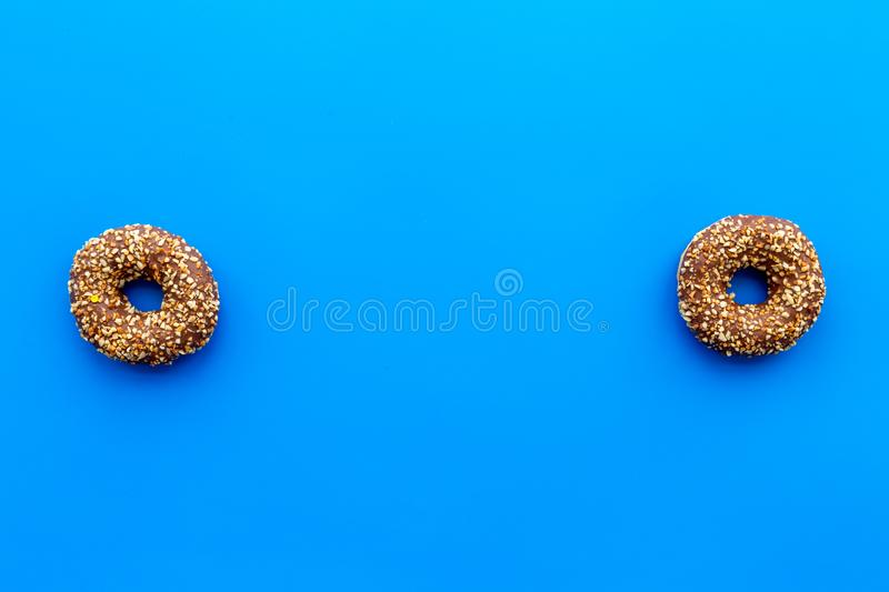 Sweet tasty snack. Glazed donut on blue background top view copy space royalty free stock photos