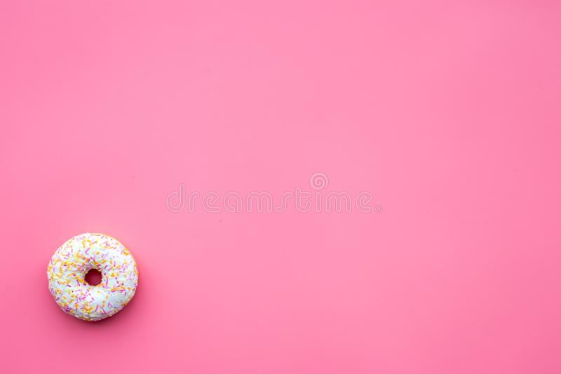 Sweet tasty snack. Glazed donut on pink background top view copy space royalty free stock images