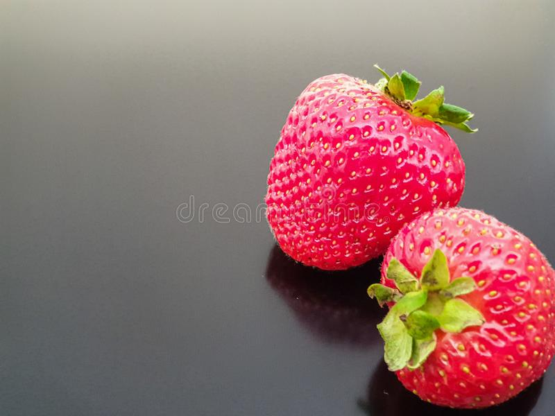 Sweet tasty strawberries on dark background with space for text. Strawberry, fruit, food, vegan, veganism, isolated, red, fresh, freshness, ripe, healthy stock photos