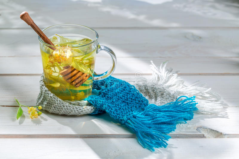 Sweet tea for cold evenings. On old wooden table stock images