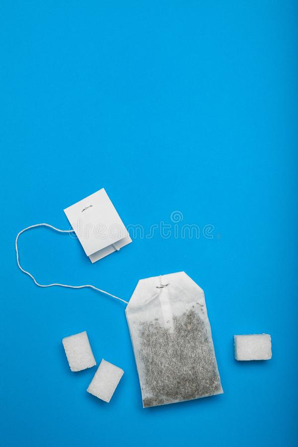 Sweet tea with sugar, a bag of tea. Empty space for text royalty free stock image