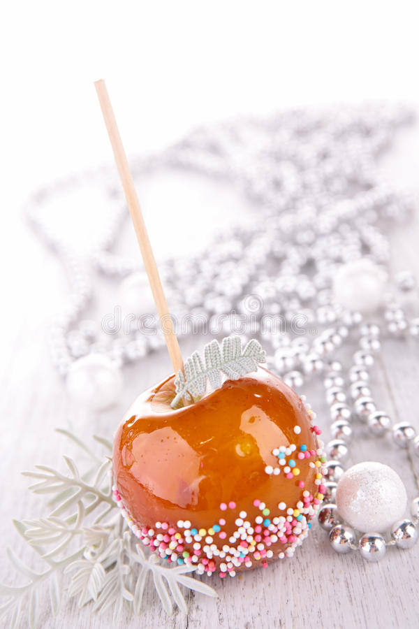 Sweet toffee candy apple. Close up on sweet toffee candy apple royalty free stock image