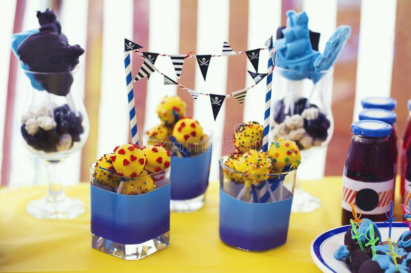 Sweet treat on the table. Cake-pop, drinks for the baby. Pirate party on a summer day stock photos