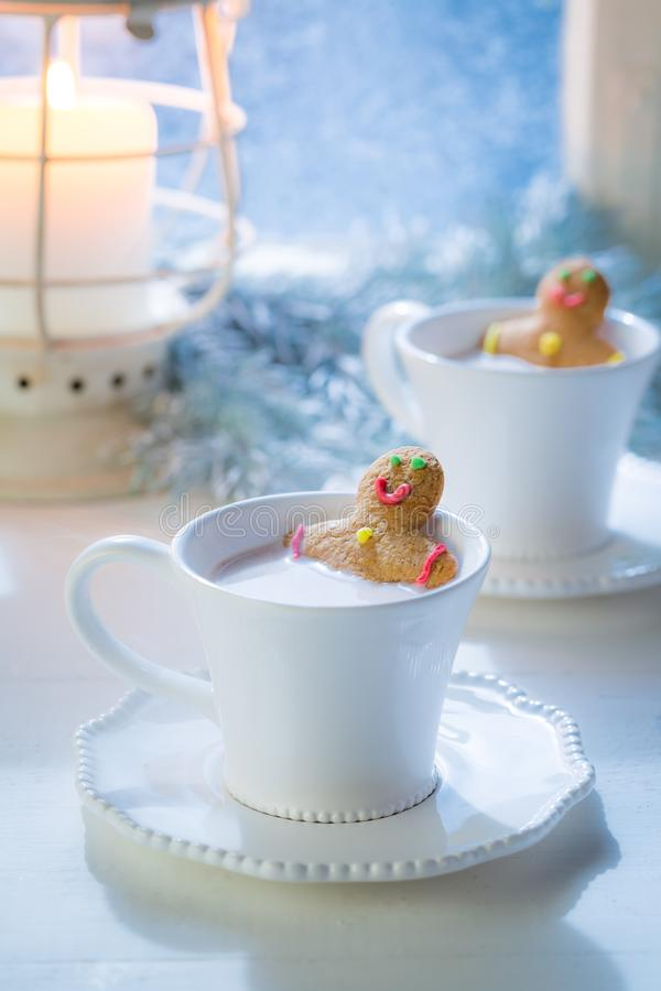Sweet two gingerbread man relaxing for Christmas. On white table royalty free stock photos