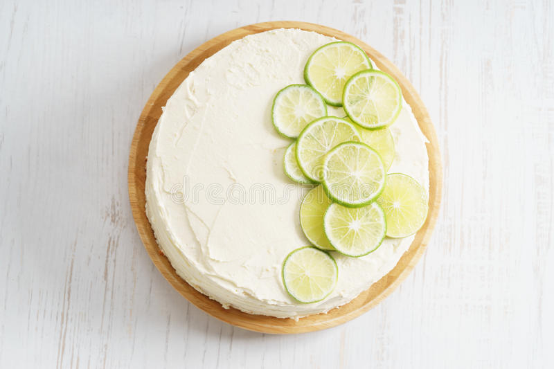 Sweet white buttercream cake with sliced lime on top royalty free stock photo