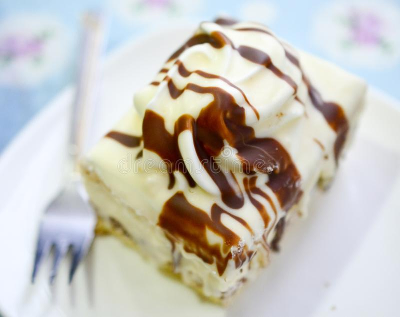 Sweet white chocolate cake in a plate. Image stock images