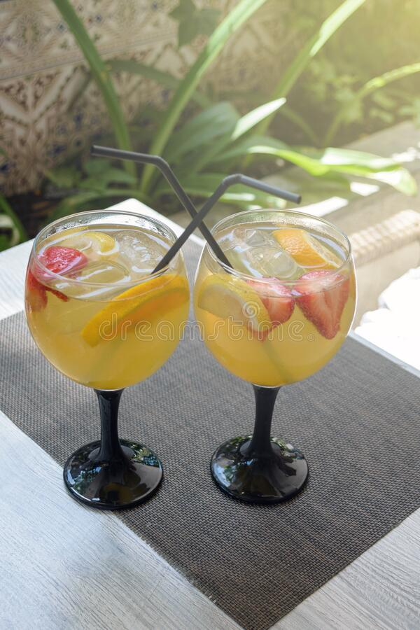 Sweet white sangria fruit in glass goblets on the table. Traditional spanish food. Two glasses on a table in a Spanish restaurant. In Mallorca royalty free stock photography