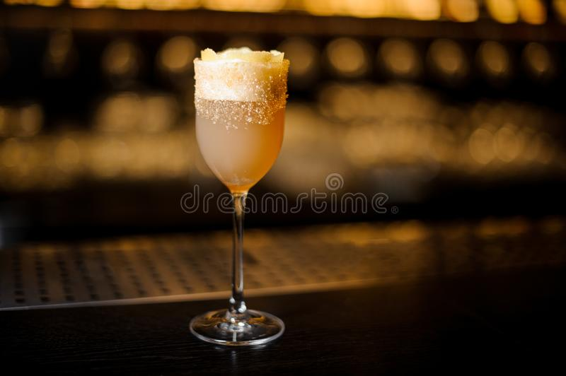 Sweet wine glass filled with delicious brandy crusta cocktail on royalty free stock images