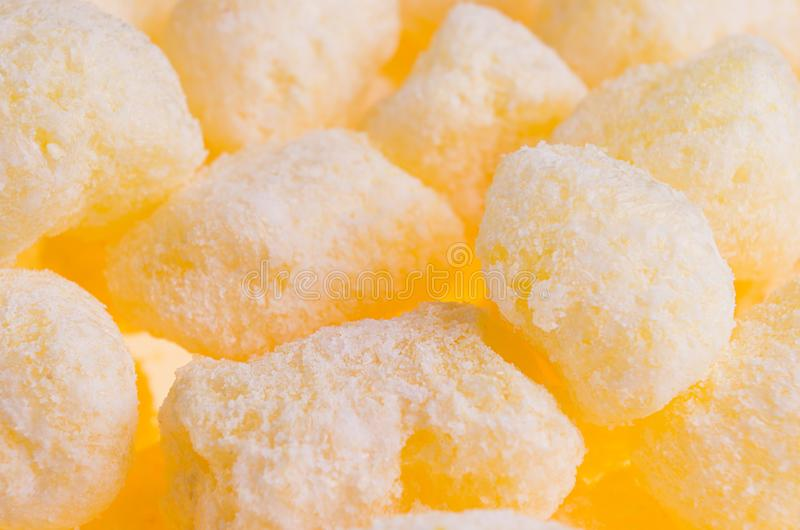 Sweet yellow corn sticks with powdered sugar background, closeup. Sweet yellow corn sticks with powdered sugar background, closeup stock photo