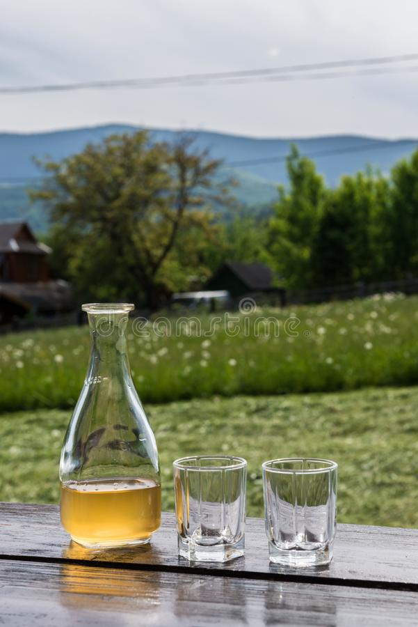 Sweet yellow honey wine meade in beautiful mountain landscape. Ready to drink. stock images
