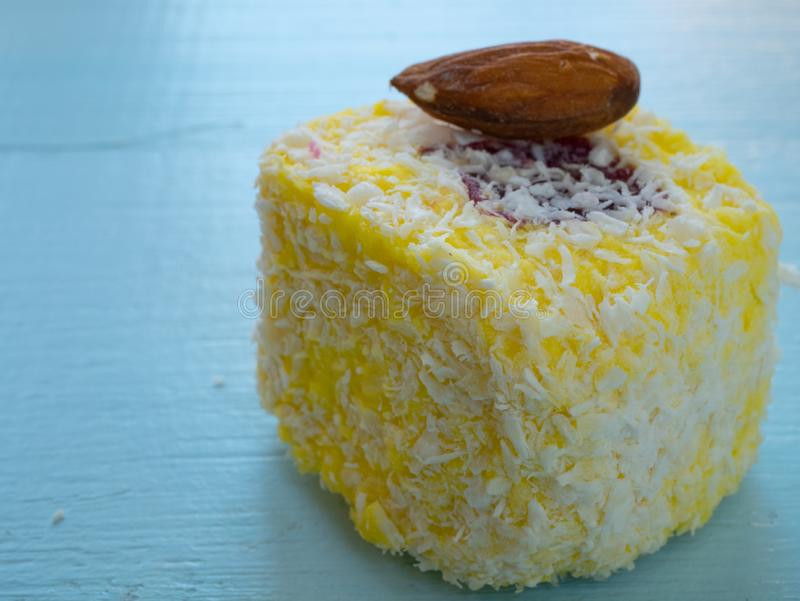 Sweet yellow turkish delight candy with almond stock images