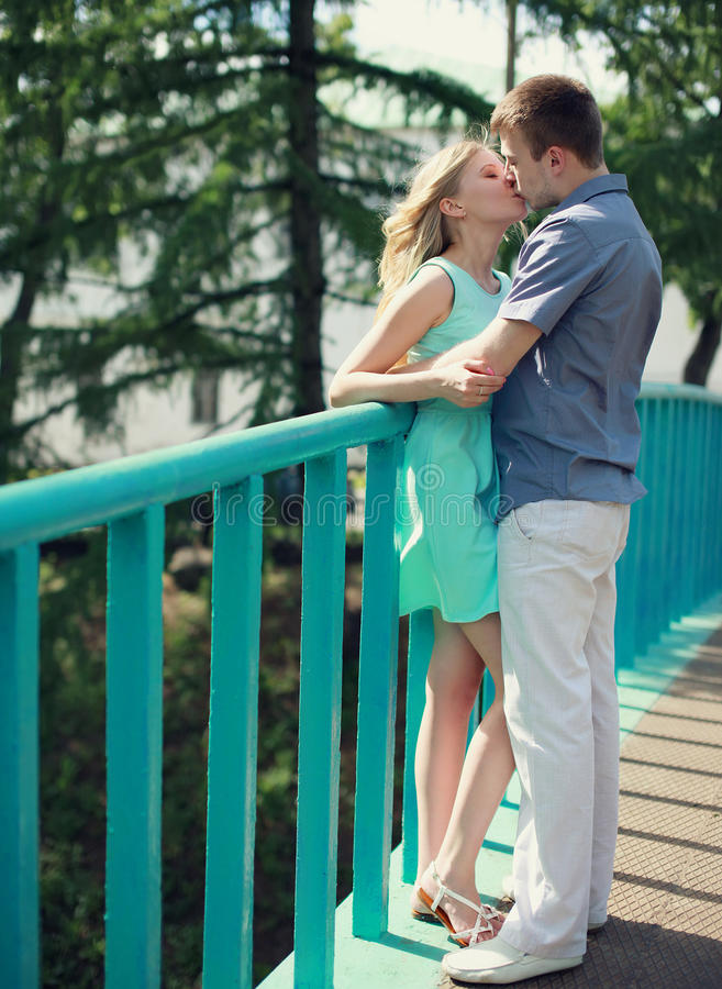 Sweet young couple kissing. In the city summer royalty free stock image