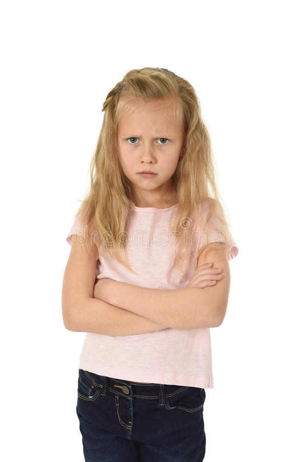 Sweet young schoolgirl with blond hair and folded arms angry upset frustrated and unhappy. Cute and sweet young schoolgirl with blond hair and folded arms stock image