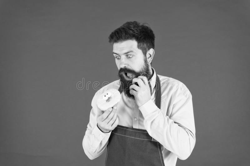 Sweetie hipster. baker hold donut. Funny hipster. Bearded man cook. Chef man in cafe. Diet and healthy food. Bearded man stock photo
