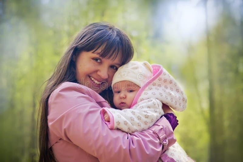 Sweetness. Outdoor portrait of happy mother with daughter
