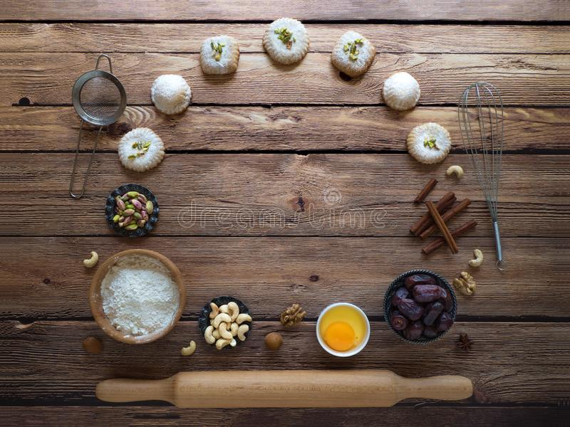 Sweets background. Egg, flour and nuts are laid out on a dark background. Sweets background. Egg, flour and nuts are laid out on a dark background royalty free stock photography