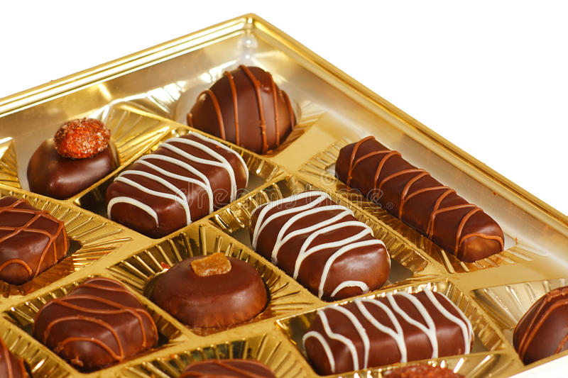 Sweets from a black and white chocolate stock images