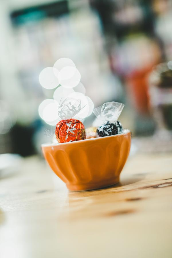 Sweets in bowl, Christmas time, blurry background royalty free stock image