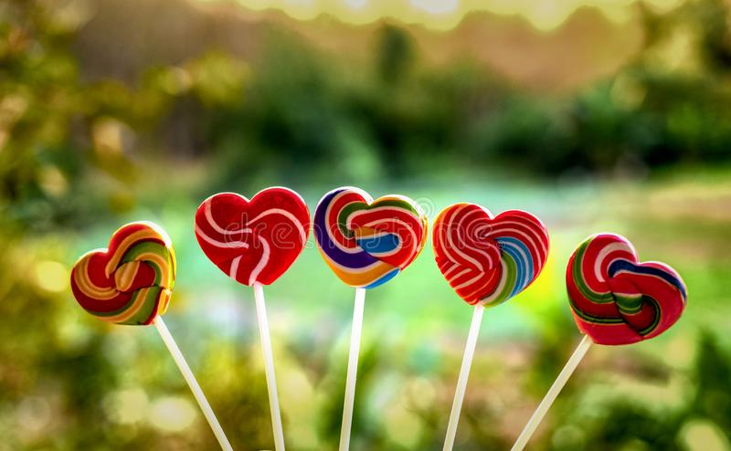 Sweets candies heart shape color full on blurred background, Set candy of color rainbow lollipops, Gift for Valentine day royalty free stock photo