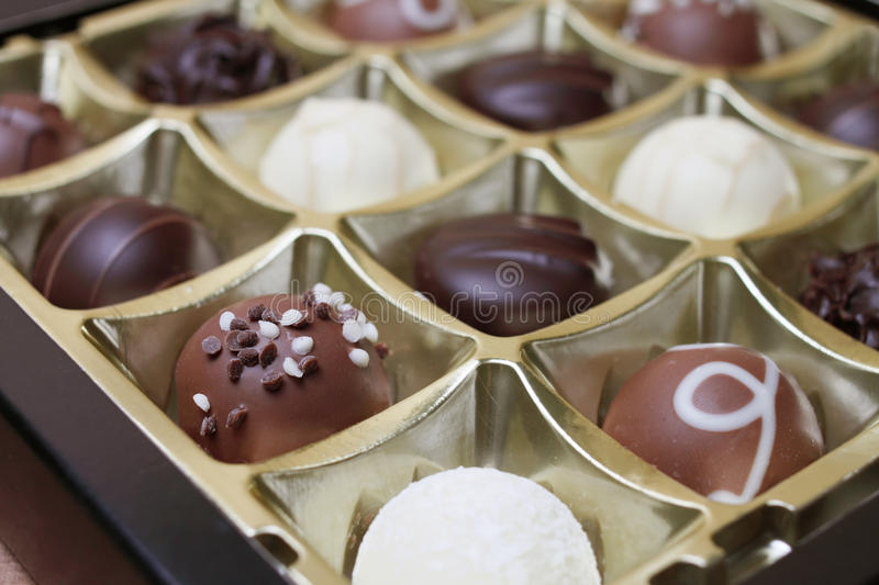 Sweets in a chocolate box stock photos