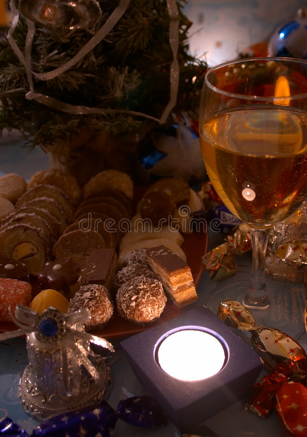 Sweets at Christmas time. Christmas Table with candle light