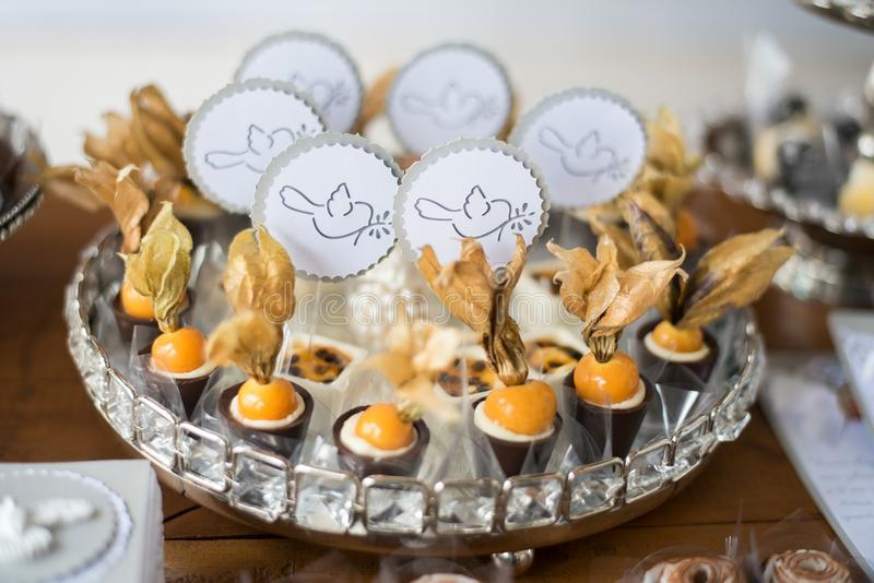 Sweets and decoration on the table - Baptism theme stock photography