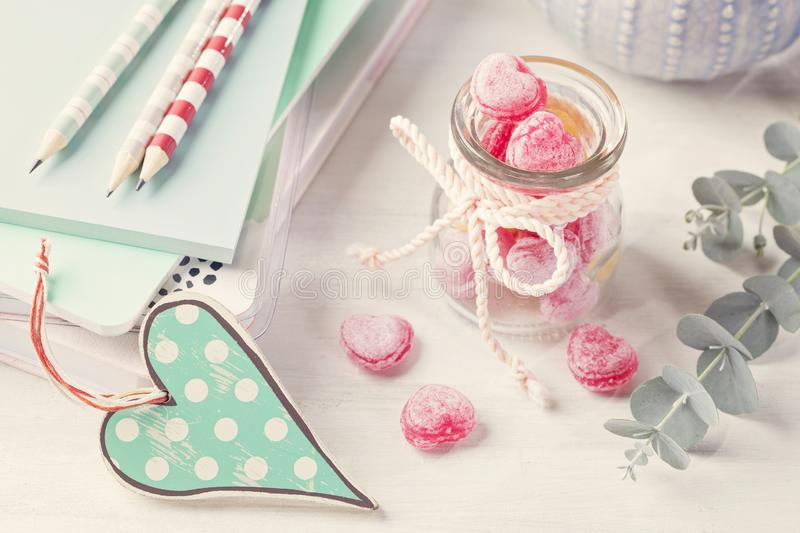 Sweets in a glass jar. On a table stock photos