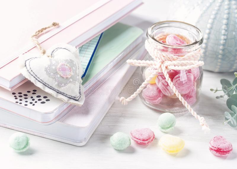 Sweets in a glass jar. On a table stock photo